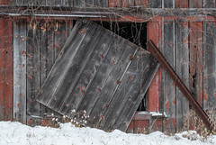 Winter Barn 2 (rickhanger) Tags: barn barndoor farm abandoned abandonedbarn abandonedfarm winter snow snowing cold