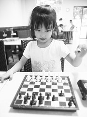 Basketball Day GuoGuo 13 (ArdieBeaPhotography) Tags: small little girl child kid young elementary schoolage primary play fun cheeky mischievous active busy friendly cute pretty white tshirt daughter chess board pieces move strategy
