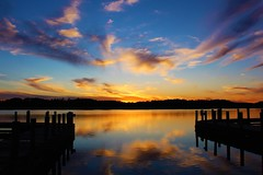 The sun and Denbigh Pier (Artist Victoria Watson) Tags: sunset colorful reflections happynewyear river pier water clouds sky dusk greaterphotographers sun light silhouettes