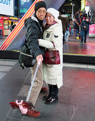 They'd traveled a Long Way for this Selfie - Times Square, NYC (TravelsWithDan) Tags: couple asian selfie photo portrait selfiestick night urban city candid streetphotography timessquare nyc newyork canong3x cold winter hugging theotherphotographer