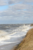 Pounding the Coastline (eyriel) Tags: water bay shore shoreline nature wave waves wind windy spray grass beach sand