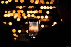 Candlelight - Wien, Austria (Sebastian Bayer) Tags: kerze kirche dunkel feuer lichtpunkte fotografieren smartphone handy person kerzenständer bokeh licht kerzenschein hand mystisch
