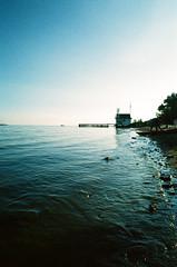 Sky and Water (Georgie_grrl) Tags: crossprocessed 35mmfilm pentaxk1000 rikenon12828mm ontario cherrybeach toronto lakeontario shoreline waves water lake lifeguardhouse sky beach explore