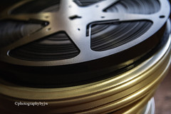 Reel to Reel (Photographybyjw) Tags: reel old film cans 16mm movie found north carolina ©photographybyjw window light rural country metal
