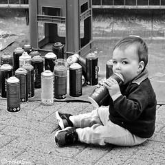 A FUTURE GRAFFITI ARTIST (Akbar Simonse) Tags: holland netherlands nederland spraypaint spuitbus candid street streetphotography straatfotografie kid akbarsimonse bw blancoynegro bn zwartwit spraycan vierkant square urban