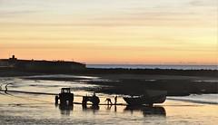 Coble Launch Sunrise (Gilli8888) Tags: newbigginbythesea newbiggin northeast coast seaside northumberland sunrise shoreline seascape sun sky rocks beach turbines northsea nikon p900 coolpix silhouette silhouettephotography tractor coble vehicle newbigginbeach launch