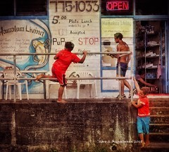 "PuPu Stop, Honokaa, Hawaii (augenbrauns) Tags: bigisland hawaii honokaa playing children door telephonenumber red ironrailing concretesteps signs wallmenu menu lunchstop food pupustop pupu ""exoticimage"" netartii artdigital"