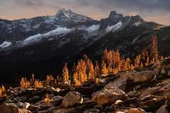 Autumn Larches on fire (hoangcuongnokia8800) Tags: 500px mountain range hill scenery hiking ridge scenic snowcapped hike peak pass pacific northwest sunset twilight sunrise colors rock summit nature outdoor highlands view alpine larch tree grove travel trip tourism park