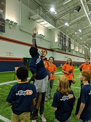 2018_T4T_Denver Broncos Play 60 Clinic 23 (TAPSOrg) Tags: taps tragedyassistanceprogramforsurvivors teams4taps denverbroncos englewood colorado nfl salutetoservice football play60 2018 military indoor vertical kids children player candid highfive