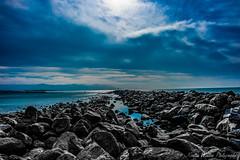 The Blues (Kerstin Winters Photography) Tags: ocean water sea sky rocks landscape bay california outdoor colors strand bucht kalifornien landschaft meer wasser nikon nikondsl nikondigital nikkor flickr fotografie photography selectivecolor blue blau farben black white morrobay