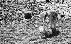 The Hunter (4foot2) Tags: candidportrate candid reportagephotography reportage people peoplewatching interestingpeople portsmouth oldportsmouth pebbles beach hunter analogue film filmphotography 35mm 35mmfilm asahipentax asahi asahipentaxsv sv takumar supertakumar supertakumar11855 supertakuma55mmf18 pentax bw blackandwhite monochrome mono rolleiretro rolleiretro400s 400s hc110 kodakhc110 kodak 2019 fourfoottwo 4foot2 4foot2flickr 4foot2photostream