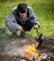 From the frying pan into the fire - literally (Jim Frazier) Tags: publicgarden 2018 5000people american ash ashes bandana botanic botanicgarden botanicalgarden botanicalgardens camp campfire cantigny cantignypark castiron cook cooking dirt dupage dupagecounty fire firepit firewood flames frame fryingpan gardens grass historic history hole horticulture il illinois iron jimfraziercom man military museum northwestterritoryalliance nwta pan park parks people preserve public q3 reenacting reenactment reenactments reenactors revolution revolutionarywar september soldiers spatula steel toexport tofinishediting uniform war warfare wheaton wood