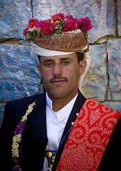 Young Groom With A Traditional Turban Full Of Flowers At His Wedding, Thula, Yemen (Eric Lafforgue) Tags: arabia arabiafelix arabianpeninsula celebration clothes clothing colourpicture day flower man noce oneperson placeofinterest portrait realpeople thula thulla turban vertical wedding yemen yemeni mg6433 amrangovernorate