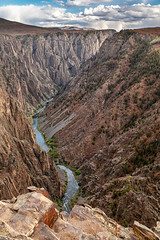 Cutting a Canyon (Kirk Lougheed) Tags: blackcanyon blackcanyonnationalpark blackcanyonofthegunnison blackcanyonofthegunnisonnationalpark colorado gunnisonriver pulpitrockoverlook usa unitedstates canyon cloud gorge landscape nationalpark outdoor park river sky water