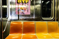 WTF? (wwward0) Tags: advertisement cc empty manhattan mta nyc poster seat subway train underground wwward0