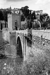 Spanish Bridge (Anna Sikorskiy) Tags: bw blackandwhite landscape panorama bridge stones old historic skyline trees grass atmosphere architecture europe spain explore canon annasikorskiy cityscape