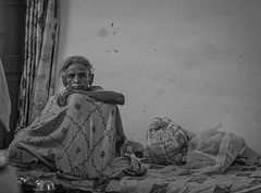 The Widows House (ybiberman) Tags: varanasi india utterpradesh old people streetphotography candid melancholic widowshouse bw blanket sitting bed woman widow