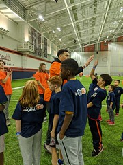 2018_T4T_Denver Broncos Play 60 Clinic 21 (TAPSOrg) Tags: taps tragedyassistanceprogramforsurvivors teams4taps denverbroncos englewood colorado nfl salutetoservice football play60 2018 military indoor vertical kids children player candid group highfive