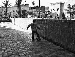 Just a boy playing football (raakf) Tags: streetphotography streetlife monotone bw monoart monochrome bnw blackandwhite 1750mm d500