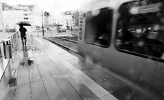 Monday morning (Guido Klumpe) Tags: strasenbahn station platform germany hanover unposed candid street streetphotography streetphotographer reflection rainy rain frau women lady beauty kontrast contrast gegenlicht shadow schatten silhouette