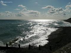 Norfolk Seaside (camerapoetry) Tags: cromer norfolk seaside poetry poem words images ocean water waves seashore beach blue sky white clouds