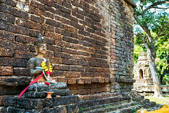 Ephemeral Flowers and Sturdy Stones (Matt Molloy) Tags: mattmolloy photography mahachedi mahaphowihan sevenpeaks sculpture statue pose pray red yellow flowers shrine worship buddhist temple religion symbolism tree watchetyot watphotharammahawihan chiangmai northern thailand lovelife