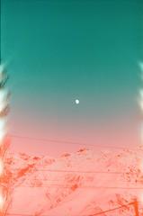 The Moon is Down (Tamar Burduli) Tags: tamarburduli analog 35mm film nature landscape travel sky moon skyscape mountains mountainscape lightleak skyporn winter snow kazbegi georgia stepantsminda zenit fujifilm fuji