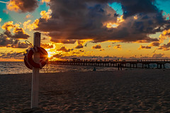 Hidden the sun with the lifebelt. (_VicRos_) Tags: lifebelt sunrise beach pier clouds sky sand fort lauderdale by sea