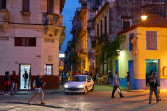 Havana, Cuba (szeke) Tags: cuba havana street night lights people walking buildings car store blue pink tourist sky standing