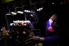 Shilin Night Market, Taipei. 2018 (jaumescar) Tags: taipei taipeicity taiwan night market dark woman seller shop dog glasses toy color contrast high canon lowlight streetphotography
