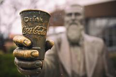 Drink a Coke (krutickr) Tags: statue cokemuseum atlanta cocacola coke