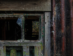 through a shed (lowooley.) Tags: allendale northpennines northernengland shed window rust paint glass dark interior