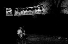 Outlaw Girl (Tim @ Photovisions) Tags: cycle minibike xt2 fuji monochrome blackandwhite fujifilm nebraska nationals races outlaw dark moody girl banner