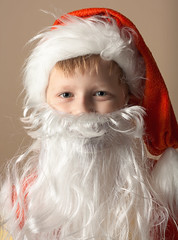 Little boy in Santa Claus suit with beard (hoboton) Tags: background boy cap caucasian celebrate celebration child christmas claus clause costume disguise emotions face grimace happy hat holiday horizontal joy kid male occasion one people person portrait red saint santa season seasonal smile suit tradition traditional wearing white winter xmas young beard vertical yellow