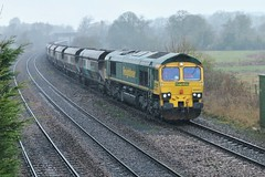 Through the Sleet (JohnGreyTurner) Tags: br rail uk railway train transport freight newbarnetby barnetby lincolnshire lincs diesel engine locomotive 66 class66 shed hoppers coal