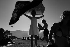 Fly away (stefankamert) Tags: stefankamert flyaway people lakecomo italy beach blackandwhite blackwhite noir light sun holidays sony rx100 rx100m2 sky bw