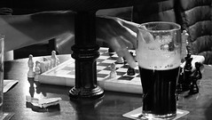 Beer Chess 02 (byronv2) Tags: beer chess game playing table board chessboard pint ale pub bennetts morningside edinburgh edimbourg scotland blackandwhite blackwhite bw monochrome peoplewatching candid street man bar drink drinking