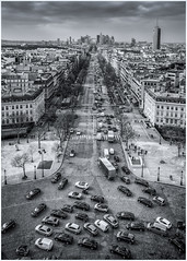 TOP OF THE WORLD1 - B&W (Fredy Laguna) Tags: arcdutriumph architectural architecture attraction blackandwhite busy cars city columns europe european france french gothic ladefense lightbeams overcast paris tourism tourist touristattraction touristdestination traffic