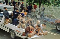 CHIANG MAI - SONGKRAN FESTIVAL (Maikel L.) Tags: asia asien thailand thai chiangmai festival songkran 1995 water wasser buddhism buddhismus buddhist fest spritzen guys people leute fun auto car coche spas isuzu ladefläche street