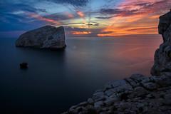 Sunset at Capo Caccia, Isola Foradadda near Alghero, Sardinia, Italy (diana_robinson) Tags: sunset sardegna capocaccia isolaforadadda largerock seastack alghero sardinia italy sea liguriansea coastline seascape bayofwater water'sedge