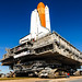 Space shuttle Discovery, atop the mobile launcher platform and crawler-transporter, approaches the ramp to Launch Pad 39A at NASA's Kennedy Space Center in Florida. Original from NASA. Digitally enhanced by rawpixel.