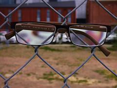 Armani Exchange (Steve Taylor (Photography)) Tags: carpark fence chainlink brown green red white glass wire newzealand nz southisland canterbury christchurch cbd city grass glasses lense spectacles digitalart building grey closeup distorted blur