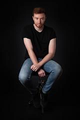 Portrait (Glennskitchen) Tags: male portrait black tshirt jeans stool dar moody redhead nikon d750 tamron 2470mm
