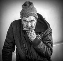 Bratislava Harmonica player..... (Kevin Povenz Thanks for all the views and comments) Tags: 2018 october kevinpovenz bratislava slovakia candid streetphotography streetportrait street streetperformer musician music harmonica canon7dmarkii blackandwhite bw male old older oldermale hat coat playing