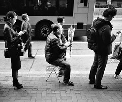 """""""hey 2019, can't wait..."""" (hugo poon - one day in my life) Tags: ricoh gr1s film kodak trix400 bus busstop hongkong northpoint kingsroad goodmorning waiting flowers phone 2019 people"""