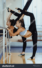 two flexible ballet dancers stretching in front of the mirror, girls dancer practicing mixed dance and stretching, extending leg up, vertical twine on dancing, girl doing acrobatic and flexible tricks (ig_royal6969) Tags: ballet ballerina dancer full length vertical twine stretching workout fitness exercise sport girl woman young fit training lifestyle body people healthy leg stretch female sportswear active athlete gym athletic health attractive caucasian pose slim strength muscular yoga warmup doing cheerleading cheerleaders team uniform splits dance gymnastics flexible teen teenager teamwork professional acrobat sale shutterstock