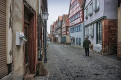 Yesterday's news (Parchman Kid (Jerry)) Tags: büdingen germany street road doors houses parchmankid sony a6000