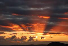Sunbeam Sunset 3 (Raphooey) Tags: gb uk england south west southwest devon sidmouth sid vale valley autumn evening dusk sun sunset sundown cloud clouds sky orange yellow beach sea seaside seashore shore shoreline town cliff cliffs peak hill wave waves beam beams crepuscular godbeams god canon eos 6d mk ii 2 mark