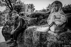 The Lady Buddha (ujjal dey) Tags: ujjal ujjaldey portrait blackandwhite monochrome contrast elder old lady dailylife chores china guilin yangshuo village candid contemplation fujifilm xe2s travel story documentary ladybuddha deity belief trust worship