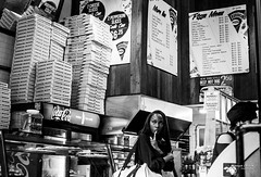 The New Yorkers - Which pizza ? (François Escriva) Tags: street streetphotography us usa nyc ny new york people candid olympus omd photo rue light black white bw noir blanc nb monochrome woman pizza fun funny soho food fast restaurant